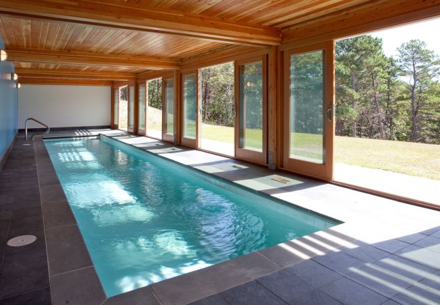 Modern-Open-Plan-Indoor-Swimming-Pool-Design-with-Varnished-Wooden-Ceiling