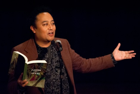 Poet Regie Cabico reading from the Queer poetry anthology he edited at the