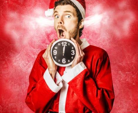 Funny xmas concept of a surprised santa in a expression of crazy stress while holding ticking time clock. Christmas mad rush