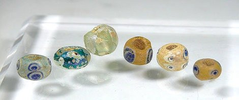 Ancient Romans glass beads, via https://www.liveauctioneers.com/item/7063927_ancient-bead-lot-roman-glass-and-phoenician-eye