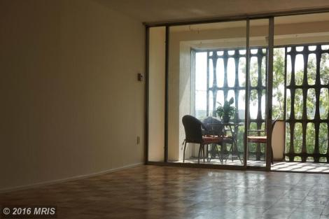 Living area - Huge sliding glass doors lead to private balcony.