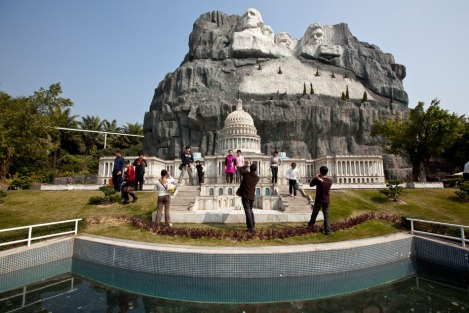 Visitors scramble up the steps of the United States Capital beneath Mount Rushmore at Windows on the World